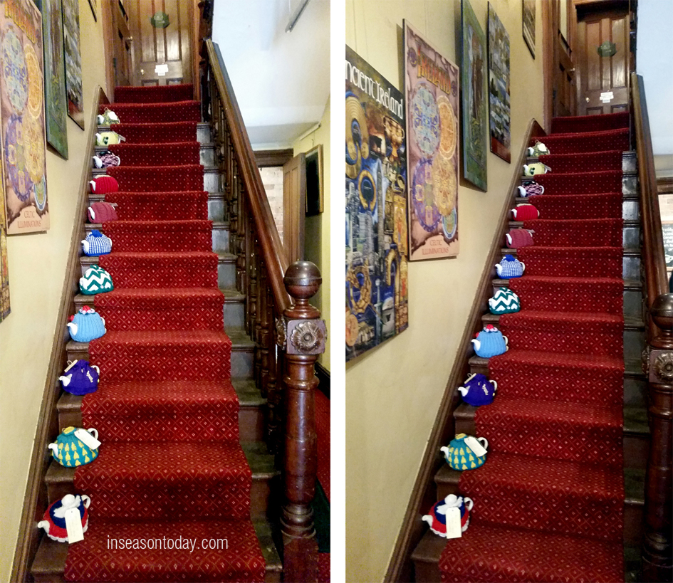 The lovely staircase with lovely teapots in cosies!